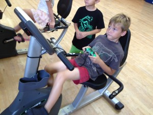 A child at the Camelback Village Health Club & Spa trying out the newly installed Exerbike.